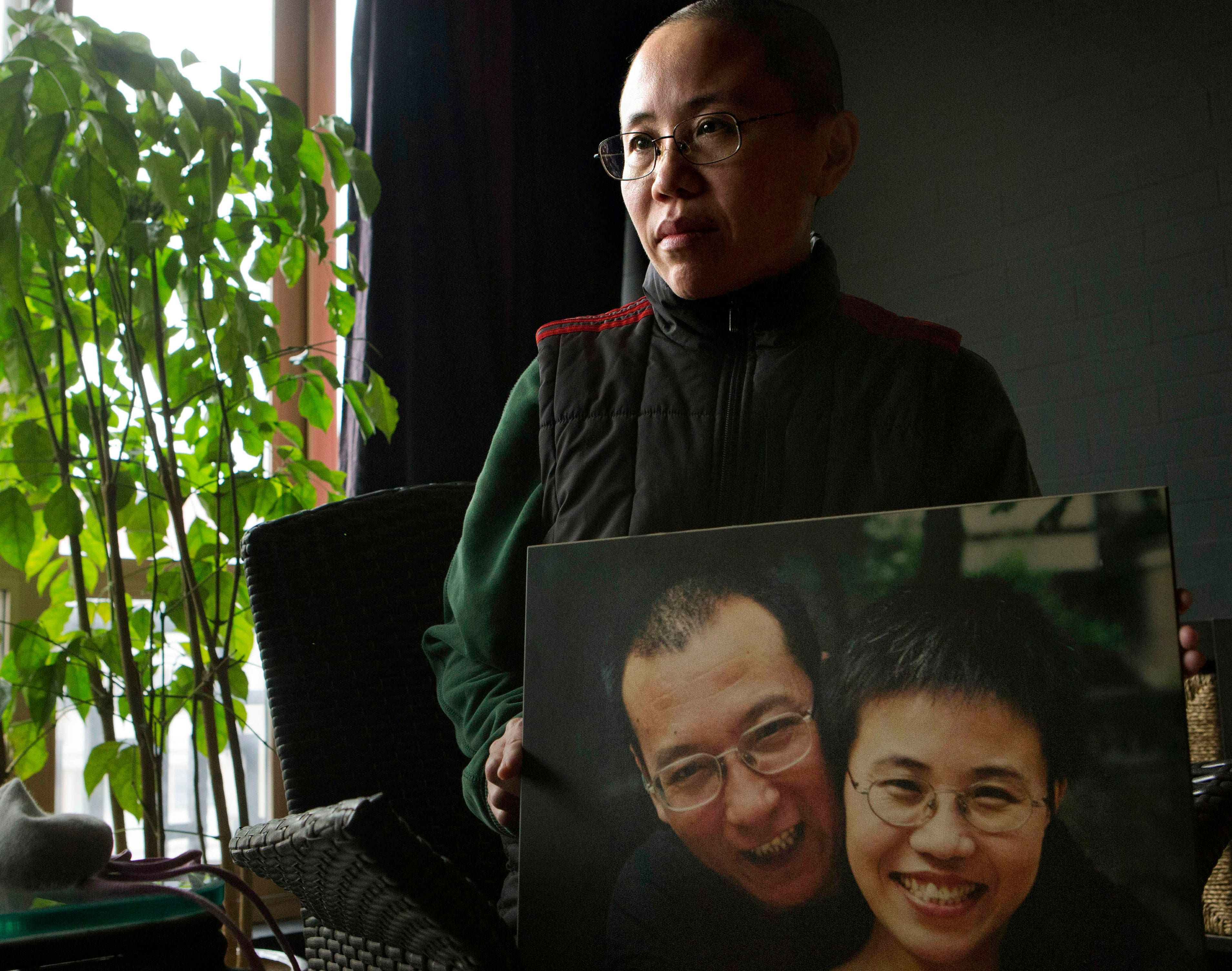 China frees Nobel widow from house arrest