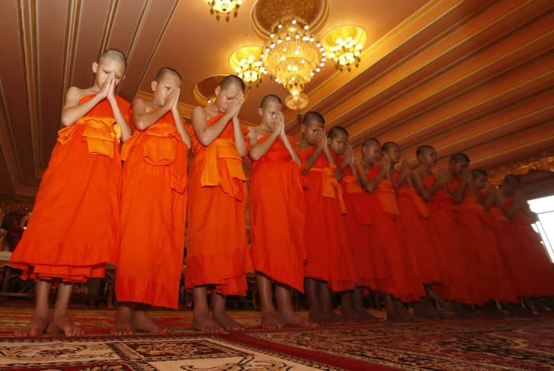 Rescued Thai cave boys graduate as Buddhist monks, pay tribute to deceased navy personnel