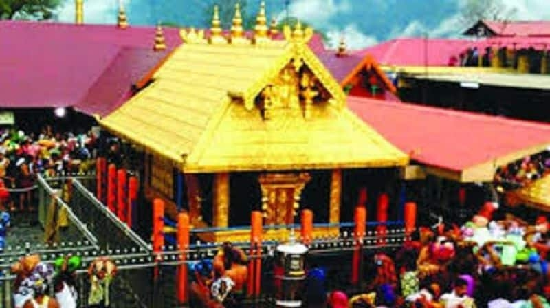 Sabarimala temple 25-year-old woman reaches  darshan with family