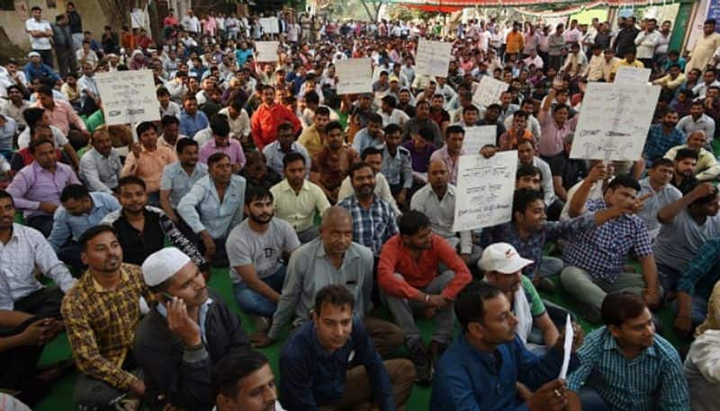 Delhi Transport Corporation strike better pay union workers protest minimum wage