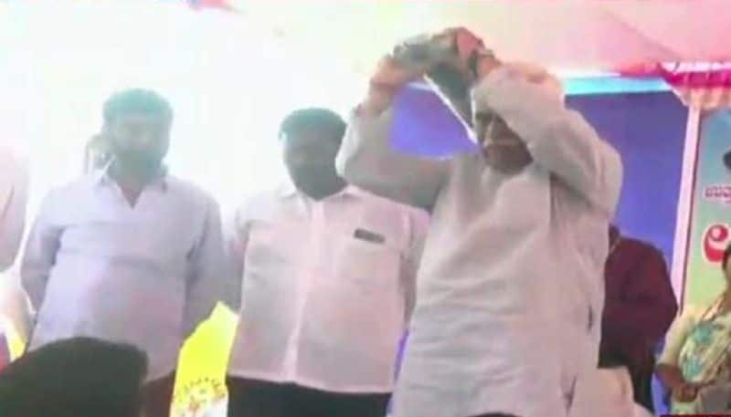 Karnataka minister insults athletes, throws sports kits at them from stage