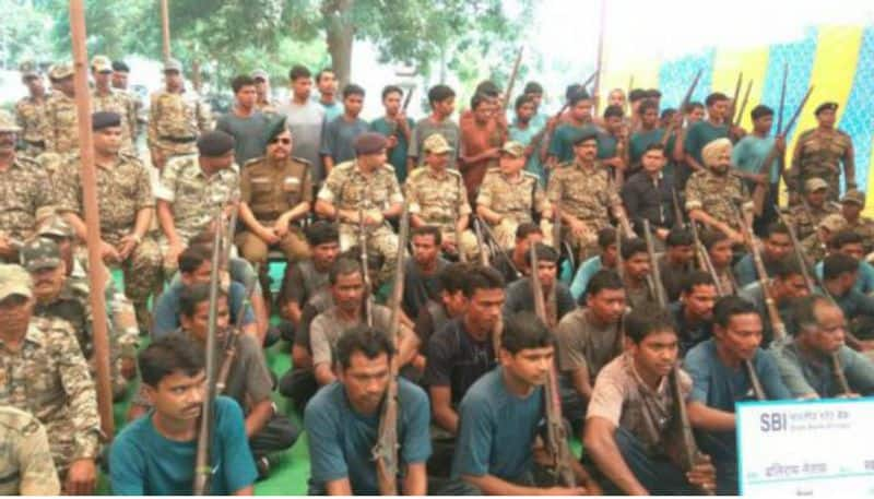 Sixty-two naxals surrender Bastar Chhattisgarh Assembly elections