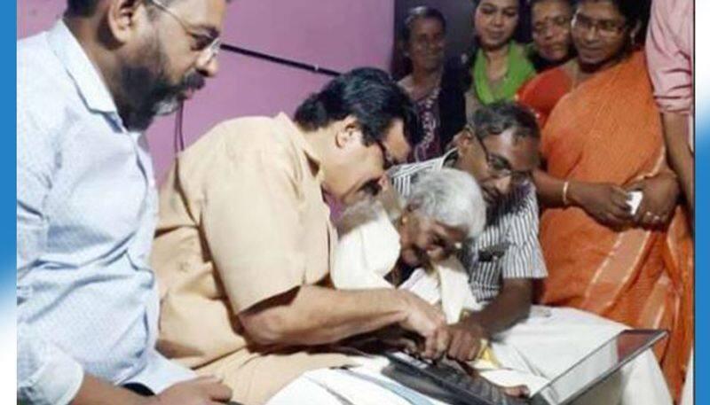 Karthyayani Amma tops exams Kerala minister C Raveendranath laptop
