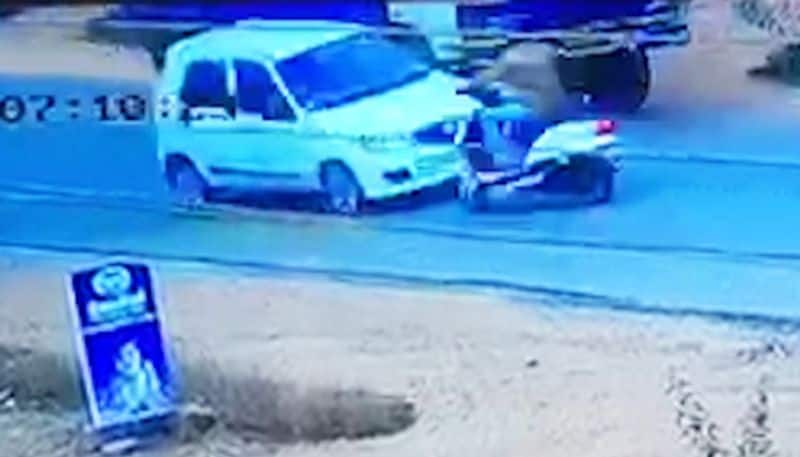 Karnataka man miraculous escape bike hits car, truck Mangaluru accident