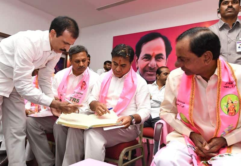ktr sat besides to kcr in trs state executive meeting