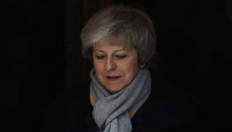 Brexit UK Parliament rejects Theresa May divorce deal political future uncertain