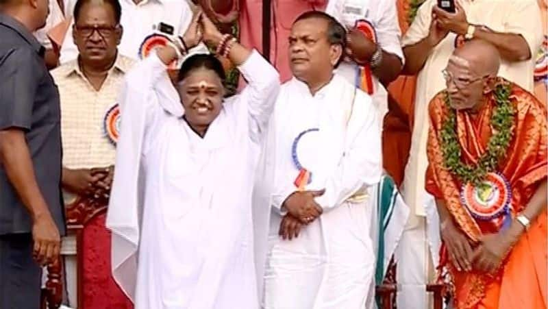 Sabarimala Mata Amritanandamayi attends Ayyappa Bhakta Sangamam CPM secy ridicules spiritual leader