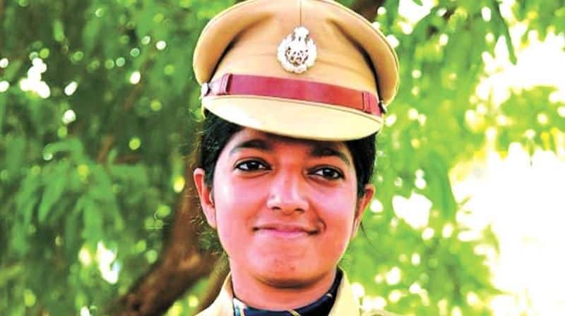 Woman IPS officer raid CPM district office transfer Kerala government Chaitra Teresa John