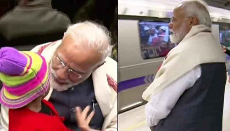 PM Modi takes metro ride ISKCON interacts commuters takes selfies