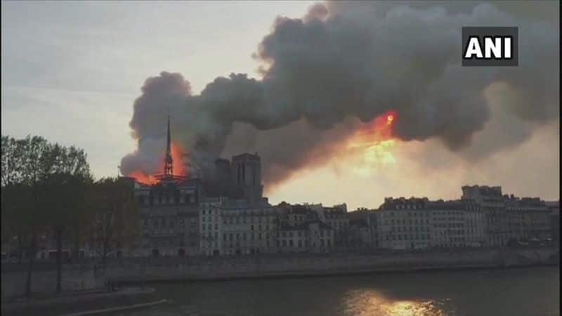 Notre-Dame Cathedral blaze: Parisians console each other amid talks of rebuilding