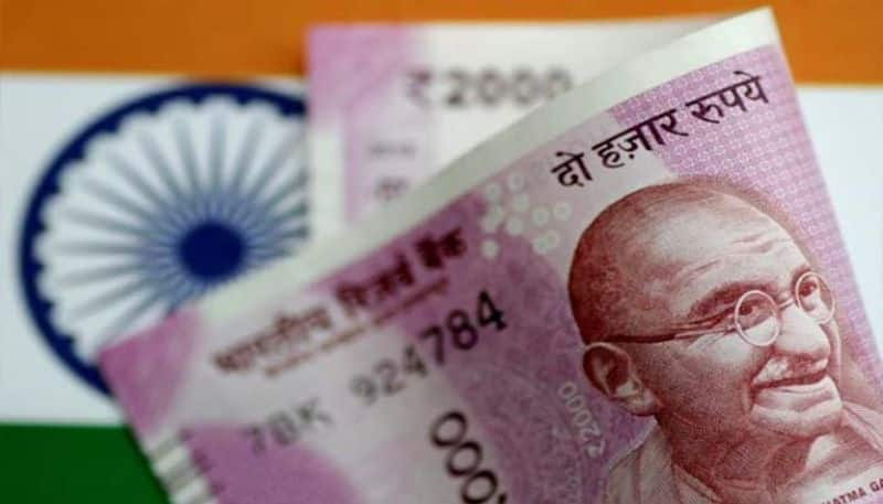Rupee falls 17 paise against USD in early trade; Weak dollar, softening crude prices restricts drop