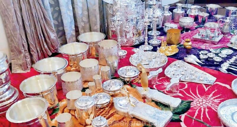 a business man  gifted gold and silver things for his daughter marriage