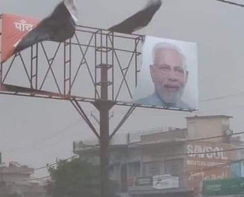 modi  banner doesnot affected even by fani cyclone and bjp enjoys about this incident
