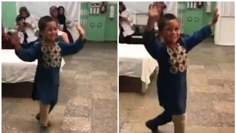 Afghan boy dances after receiving prosthetic leg