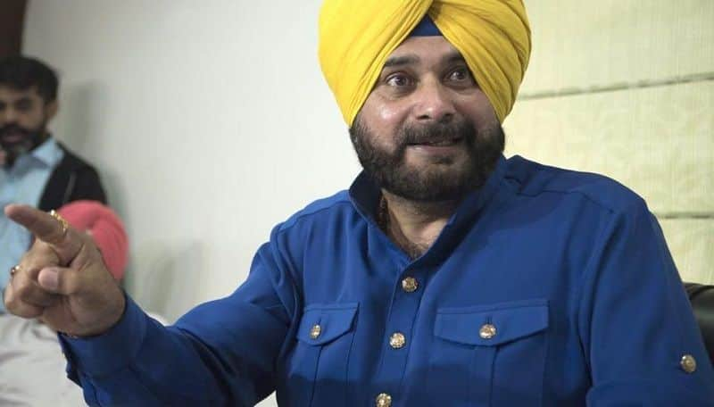 in Sidhu's rally woman throwing slippers and shown black flags