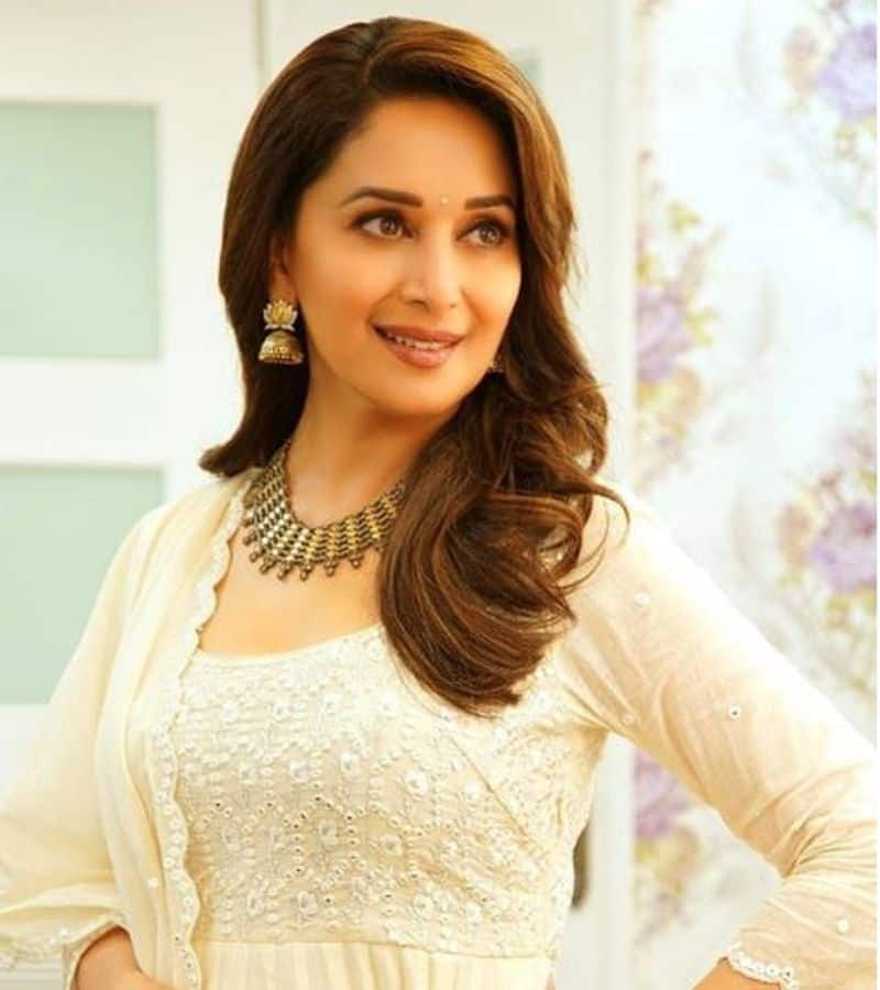 Dont miss Madhuri Dixit playing the guitar dexterously
