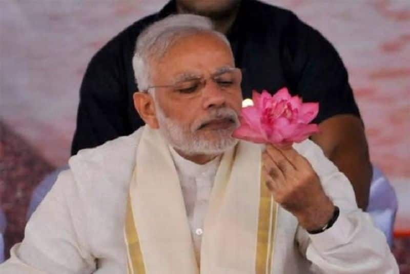 Modi on the day to become PM again