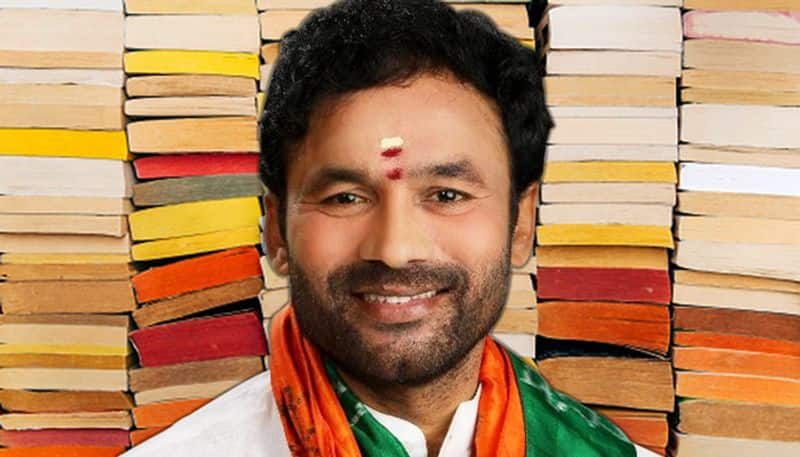Inspired PM Modi Secunderabad MP Kishan Reddy shuns garlands accepts notebooks for cause