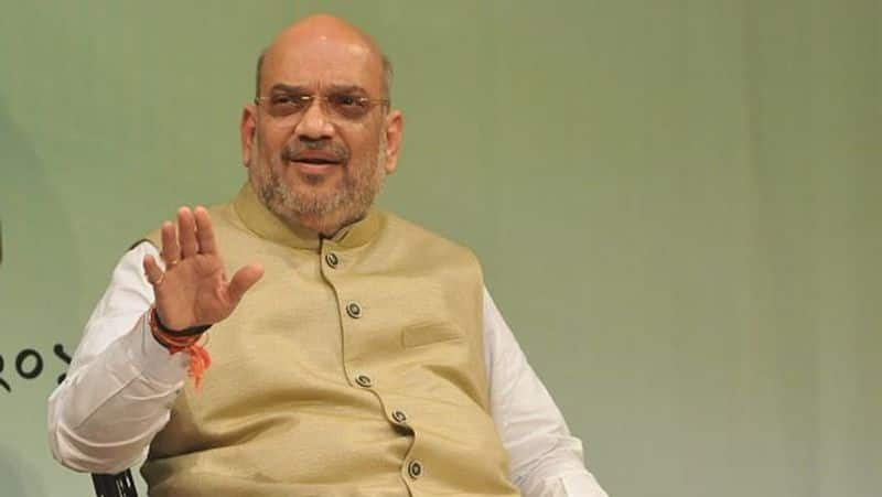 amit shah takes helm of home ministry what makes him modi right hand