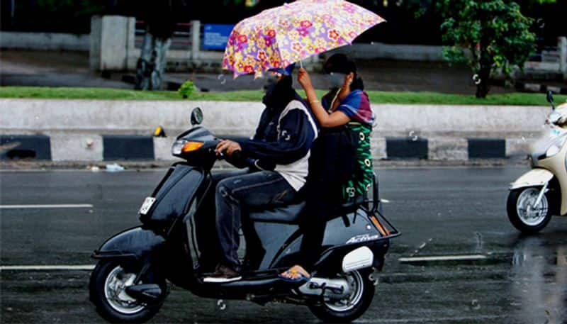 Do not try to open umbrellas when traveling on two wheelers