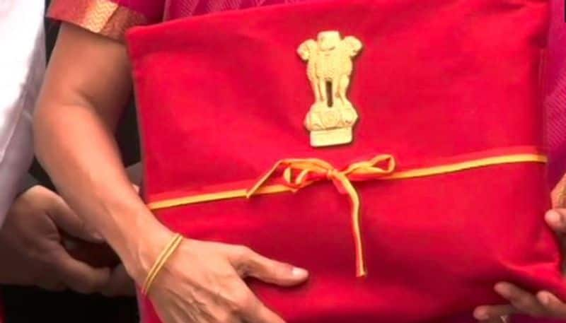 Budget copies in red cloth good bye to briefcase symbolises slavery of Western thought