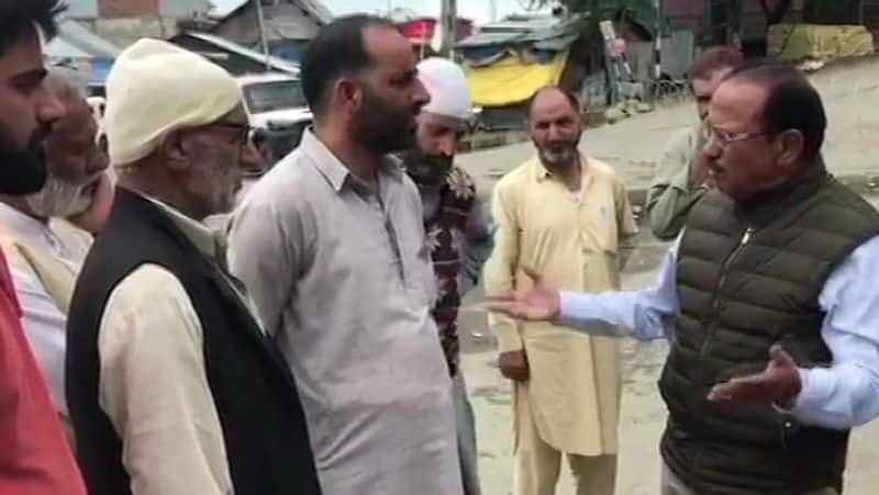 national security adviser ajit doval seen in shopian jammu kashmir with villagers