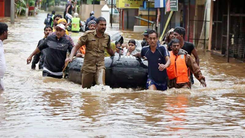 Nearly 100 people died in floods and rains in three states