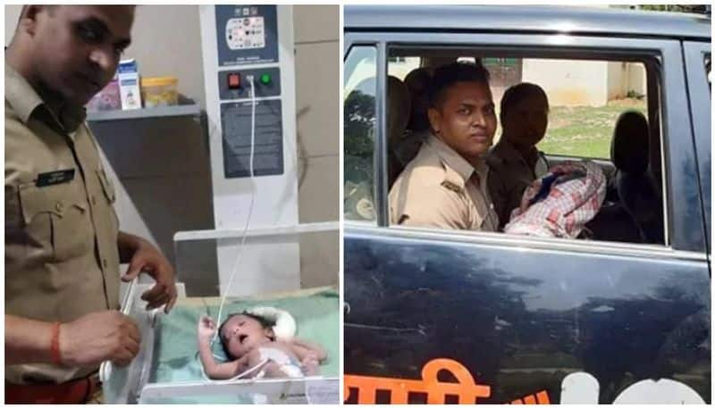 new born baby rescued from drain by police