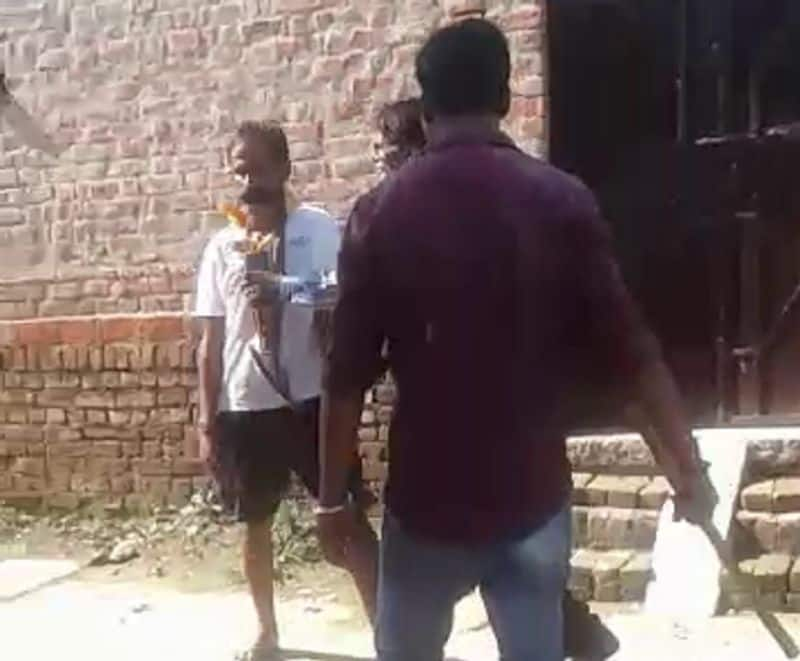 gram pradhan beaten and humiliated a young man brutally