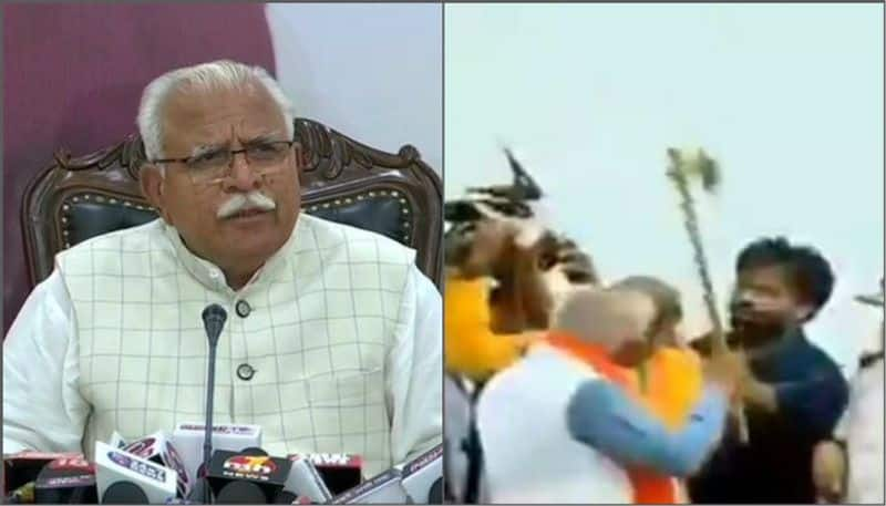 Haryana Chief Minister Khattar threatens to chop off a party worker's head with an axe during a rally