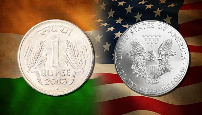 Rupee opens higher by 14 paise at 70 73 against USD in early trade