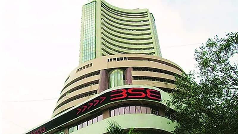 Auto and metal stocks gain; equity indices lay largely flat