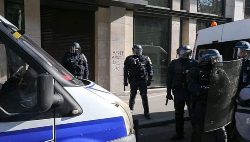 Knife attack at Paris police headquarters injures 2 officers, assailant killed