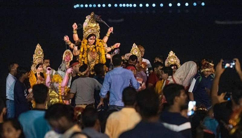 People from other religious community pelt stones at youth partaking in Durga idol procession, eight held