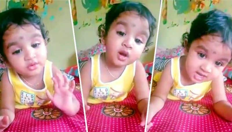 A little baby sings a song of Lata Mangeskar caught in video