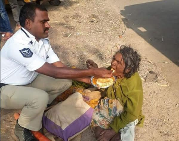 Kind Hyderabad traffic cop feeds a homeless woman
