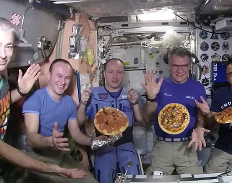 Watch the space station astronauts make pizza in microgravity conditions