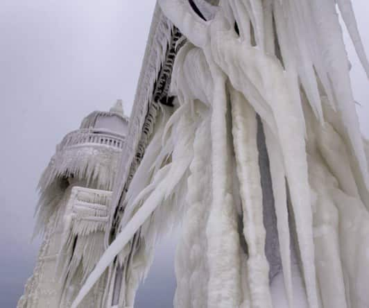 lighthouse gets a spectacular icy makeover