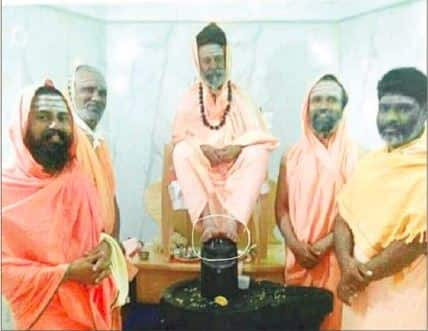 Seer places his feet on Linga says it is their ritual devotees angry