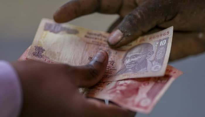 Indian rupee all time low dollar 70 currency market value lost downturn