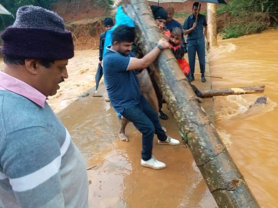 MP Pratap Simha join hands with Public in Kodagu flood