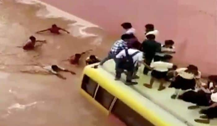 School kids rescued after their bus got stuck in waterlogged underpass