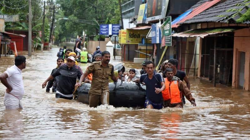 Kerala floods CMDRF Singapore Malayalee community local Red Cross SGD 50,000