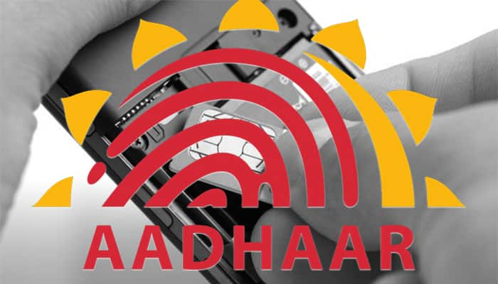 One crore fine banks telecom insist Adhaar Modi govt strict privacy norms