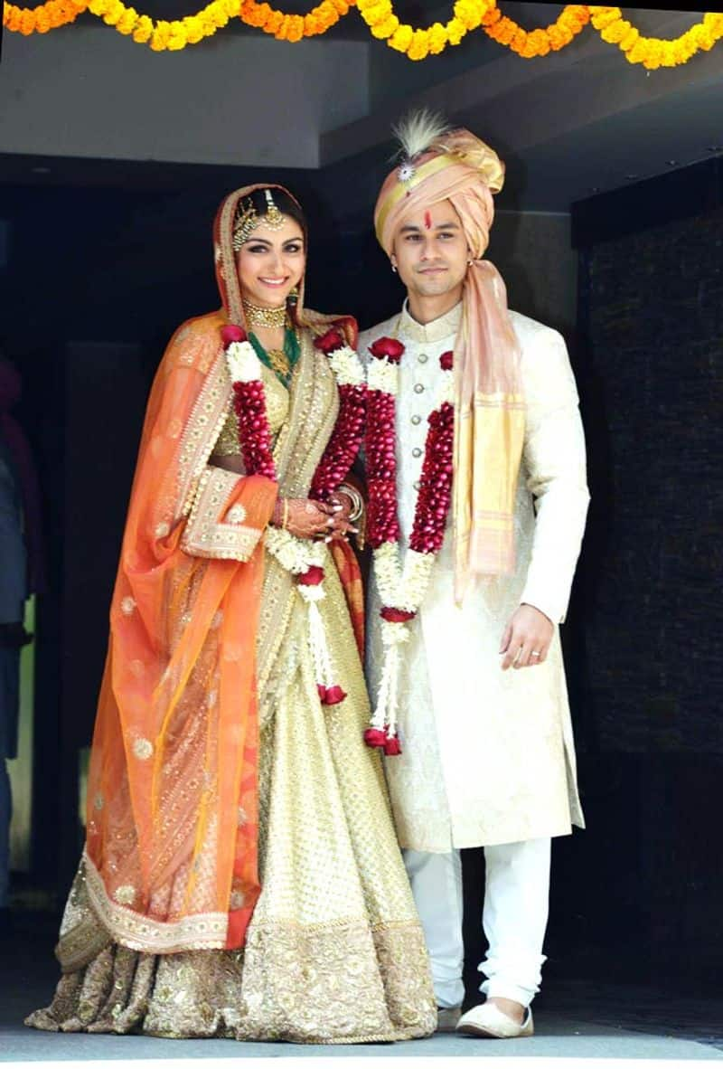 To exchange vows with husband, actor Kumal Khemu, Soha Ali Khan chose a lehenga from the designer's Opium collection. The orange and gold outfit was paired up with heavy jewellery and a passa.