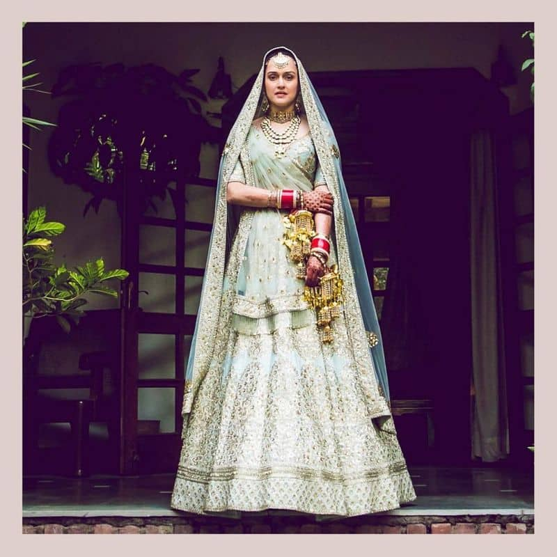Moving away from the usual bridal red, Pia chose a design from Sabyasachi's Devi collection. The duck egg blue lehenga in Indo-Victorian pattern with fine aari-taari and zardozi and minimal make-up made her really stand out.