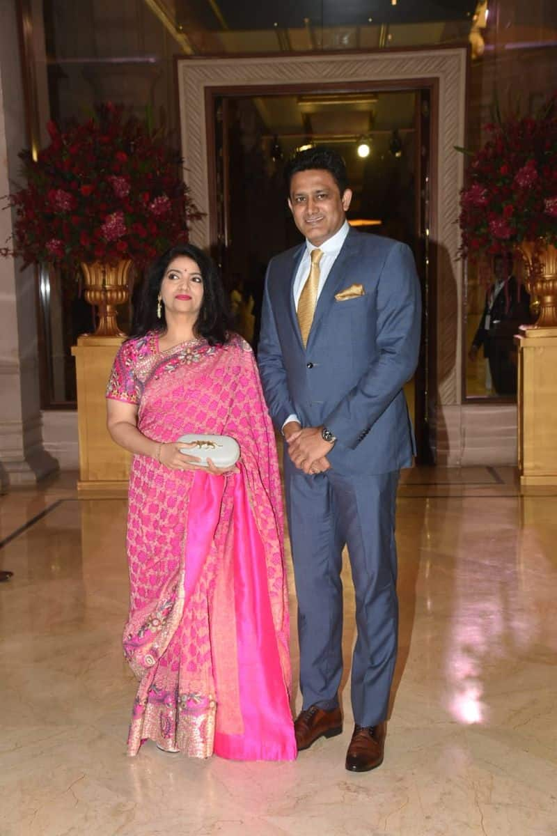 Ex cricketer Anil Kumble arrived for the reception with his wife Chethana. He wore a suit while she wore a pink saree and carried a Sabyasachi clutch.