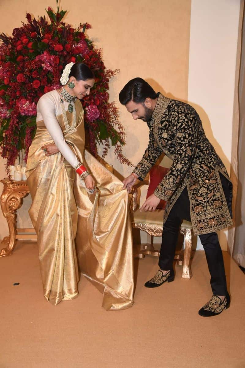 Deepika Padukone chose a gold saree gifted by her mother Ujjala Padukone for the occasion. The actress accessorised her look with a heavy emerald choker and matching earrings. Ranveer Singh, on the other hand, looked dapper in a heavily embroidered black and gold kurta by Rohit Bal.