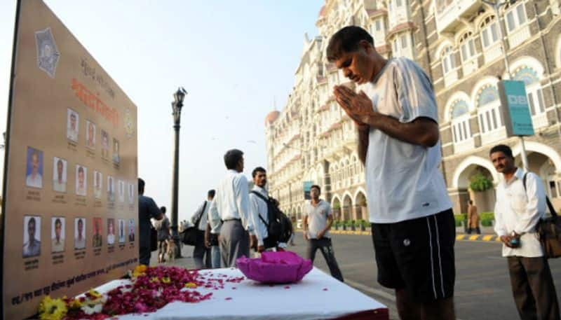 A man pays homage to those who had died in the 26/11 terror attacks at a memorial outside the Taj Mahal Palace hotel.