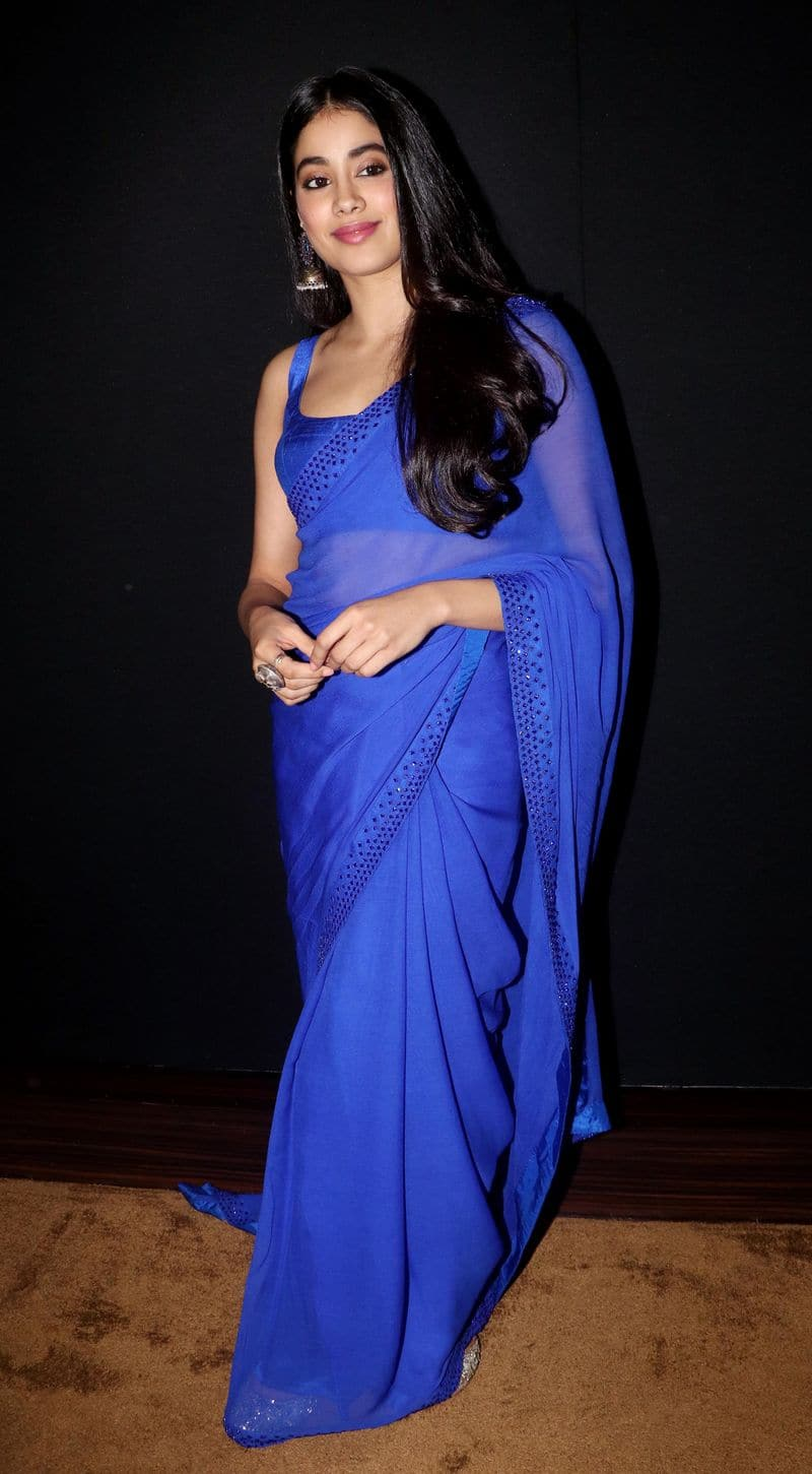 Janhvi kept her look simple by accessorising the monotone saree with a pair of jhumkas and a statement ring.